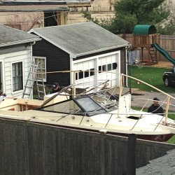 Investigators work, on  April 20, 2013, near the location in Watertown, Mass., where the previous night a suspect in the Boston Marathon bombings was arrested. Police captured Dzhokhar Tsarnaev, 19, the surviving Boston Marathon bombing suspect, in a backyard boat after a wild car chase and gun battle earlier in the day left his older brother dead. The Associated Press