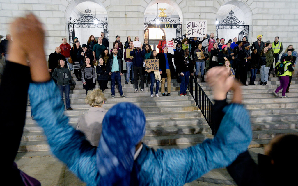 Close to 100 protesters demonstrate outside Portland City Hall on Thursday night to decry racism. The crowd went to the second floor and took over the City Council chambers for 10 to 15 minutes before leaving peacefully and protesting outside.