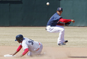 Portland #7 Marco Hernandez gets some air off his throw to first base for a double play in the fifth inning after making the tag on Reading #36 Art Charles at second base. Jill Brady/Staff Photographer