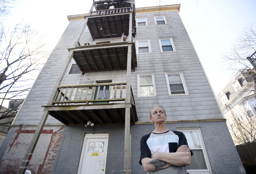 Bert Stain stands in the backyard of 563 Cumberland Ave. on Thursday, where his brother Donald Stain died after falling from the third-floor porch the day before.
