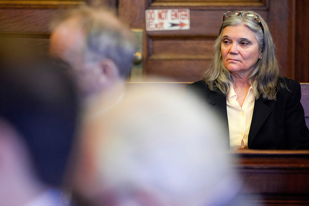 """Karen Thurlow-Kimball, wife of defendant Merrill """"Mike"""" Kimball, sits in the Cumberland County Courthouse at the start of her husband's murder trial. She testified Monday."""