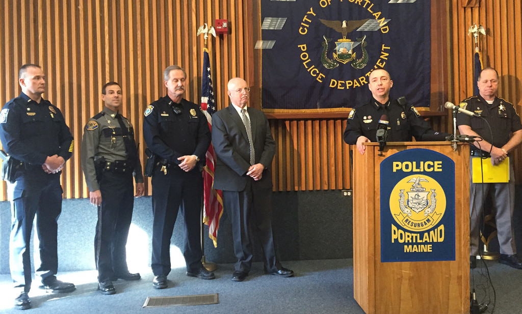 Portland Police Chief Michael Sauschuck, at the podium during a news conference Wednesday, said that a legislative effort to repeal the requirement for a concealed weapons permit would endanger the public. WIth him, from left, are Gorham's interim Police Chief Christopher Sanborn; Scarborough Capt. David Grover; Yarmouth Lt. Dean Perry; and South Portland Chief Ed Googins. At right is Cumberland County Sheriff Kevin Joyce.