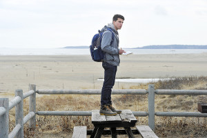 Richard Price-Sanchez, 17, from Philadelphia, Pennsylvania,  takes advantage of a picnic table to get a high view of the surroundings as Chewonki science students map the plant life on the dunes at Popham Beach. Gordon Chibroski/Staff Photographer