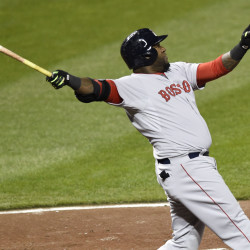 David Ortiz follows through on a three-run homer in the fifth inning Friday against the Baltimore Orioles. Brock Holt also hit a three-run homer, lifting the Red Sox to a 7-5 win.