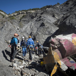 French emergency rescue services work among debris of the Germanwings passenger jet at the crash site near Seyne-les-Alpes, France.
