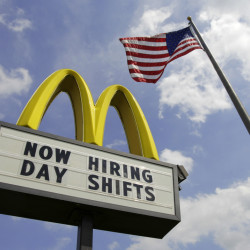 McDonald's announced Wednesday that it's raising pay for workers at its company-owned U.S. restaurants, making it the latest employer to sweeten worker incentives in an improving economy.
