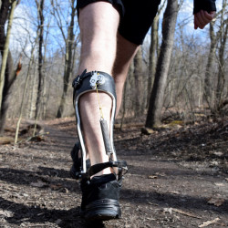 A walker tries out an exoskeleton device. Researchers say the latest exoskeleton technology is comfortable, inexpensive and requires no outside power source. The Associated Press