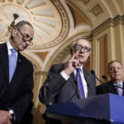 Senate Minority Leader Harry Reid, flanked by Sen. Charles Schumer, left, and Senate Minority Whip Richard Durbin at a news conference March 3, said Wednesday that he will not take sides in a dispute over who will fill the Democratic Senate leadership posts when he retires in two years.