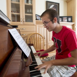 Grayson Moore, who is transgender, practices the piano at his home in Syracuse, Utah. Mormonism, with its emphasis on the physical link between bodies and spirits initially made it tougher to acknowledge what was happening inside of them, but some transgender individuals have found psychological and theological peace, even divine approval, and a support from their local faith leaders and congregations.
