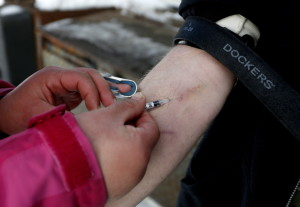 A man being treated for heroin addiction is injected with the drug replacement medication Suboxone in Portland in 2014. Maine won't gain ground in its battle against drug abuse without devoting more funding to treatment programs.