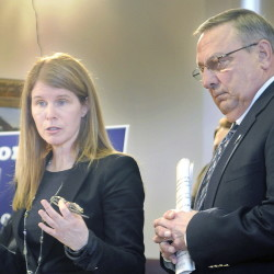 DHHS Commissioner Mary Mayhew, with Gov. Paul LePage at her side, discusses his welfare reform ideas, including requiring Temporary Assistance for Needy Families applicants to apply for three jobs before getting benefits, and tougher penalties for abusing the system.