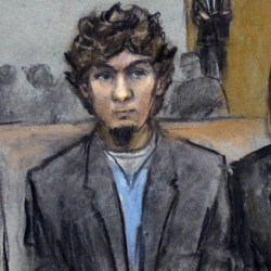 In this courtroom sketch, Dzhokhar Tsarnaev, second from left, stands with defense attorneys William Fick, left, Judy Clarke and David Bruck as the jury announces its verdict. Bruck pleaded Monday for sparing Tsarnaev from the death penalty.