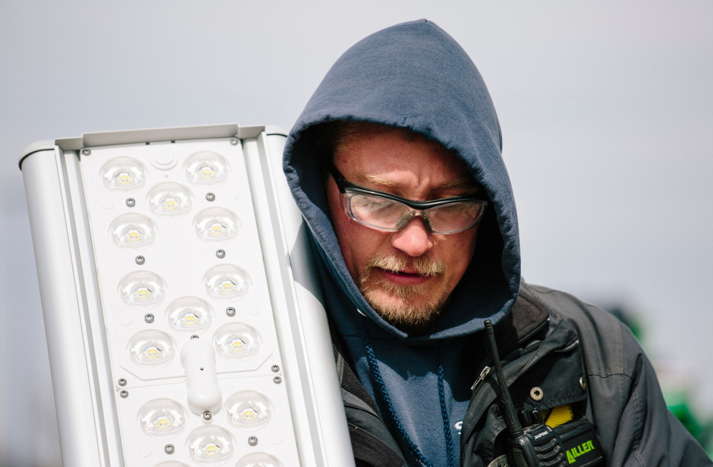 Nick Dyro holds a replacement LED light panel. Over the last year or so, LED prices have been falling fast.