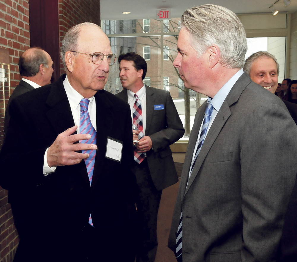 Former U.S. Sen. George Mitchell, left, chats with Colby College President David Greene prior to U.S. Sen. Susan Collins address in Waterville on Thursday.