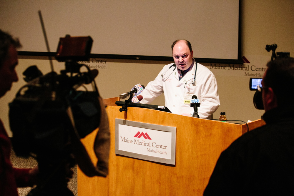 Maine Medical Center Transplant Program Director Dr. John Vella addresses members of the media to discuss whether funds raised through online crowd sourcing will prevent Josh Dall-Leighton from being eligible to donate a kidney to Christine Royles at the hospital's Dana Center Auditorium in Portland on Thursday.