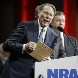 Wayne LaPierre, executive vice president of the National Rifle Association, calls upon Congress to allow gunowners with permits to be able to carry firearms everywhere. The Associated Press