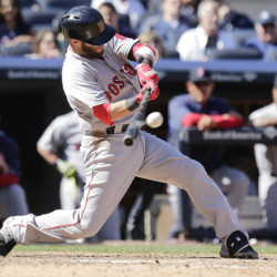 Boston Red Sox's Dustin Pedroia hits a two-run double during the seventh inning of a baseball game against the New York Yankees Saturday in New York.