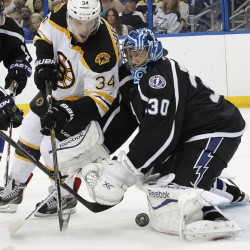 Tampa Bay goalie Ben Bishop makes a save as Carl Soderberg of the Bruins looks for the rebound Saturday night. Boston's season ended in fitting fashion with a 3-2 shootout loss.