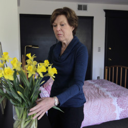 Airbnb host Lorraine Rorke Bader arranges fresh flowers at her San Francisco home before the arrival of an overnight guest. In looking at small-scale, short-term rentals, legislators in Maine should tread lightly before placing restrictions on what's still a very new market.