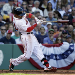 Boston Red Sox's Mookie Betts hits a three-run home run in the second inning of the Sox home opener Monday in Boston.