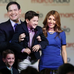 Sen. Marco Rubio holds his son Anthony after having announced that he will be running for the Republican presidential nomination, during a Monday rally in Miami. Also shown are his wife Jeanette and son Dominic.