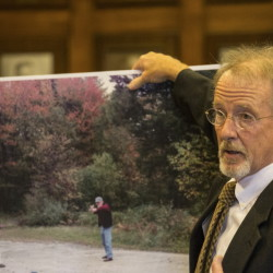 Prosecutor John Alsop displays a photo taken just after Merrill 'Mike' Kimball shot Leon Kelley in 2013. At left in the photo is Kimball's wife, Karen Thurlow-Kimball. The view of Kelley has been cropped out of the foreground.  Whitney Hayward/Staff Photographer