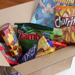A Karepax box bundles offbeat snacks such as Japanese corn-flavored gummies or pig-shaped pound cake from Thailand with independent comic books.