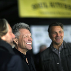 Singer Jon Bon Jovi, center, announces his foundation will open a social services center in hurricane-ravaged Toms River, N.J., later this year.