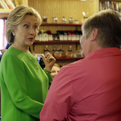Democratic presidential candidate Hillary Rodham Clinton talks with local residents at the Jones Street Java House in LeClaire, Iowa, on Tuesday.