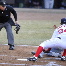 PORTLAND, ME - APRIL 14: Home Plate Umpire Jorge Teran keeps his eye on a close play as pitcher #34, William Cuevas puts the tag on New Britain runner, Dean Espy, after a passed ball. He was called safe as the Portland Sea Dogs hosts New Britain Rock Cats in AA Baseball action at Hadlock Field. (Photo by Gordon Chibroski/Staff Photographer)
