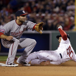 Boston's Mookie Betts slides into second with a stolen base in the sixth inning Tuesday night as Washington Nationals second baseman Danny Espinosa takes the late throw. The Red Sox went on to an 8-7, come-from behind win.