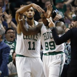 The Celtics' Jae Crowder (99) celebrates his game-winning basket with teammate Evan Turner (11) during the final second of the fourth quarter Tuesday night. The Celtics locked up the No. 7 seed in the Eastern Conference playoffs with the win.