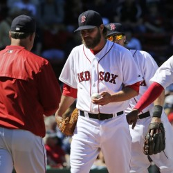 Red Sox starting pitcher Wade Miley hands the ball to manager John Farrell as he is taken out of the game after giving up a three-run double to Washington Nationals catcher Wilson Ramos during the third inning Wednesday at Fenway Park. Miley gave up seven earned runs in his short outing.