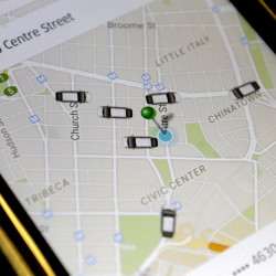 The Uber app displays cars available to make a pickup in downtown Manhattan on a smartphone in New York. Portland is trying to establish rules for the San Francisco-based ride service, which has been operating unregulated in the city since October.