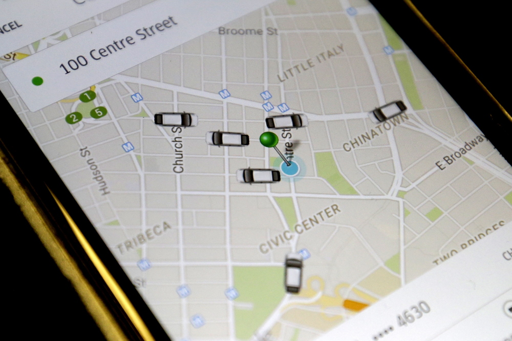The Uber app displays cars available to make a pickup in downtown Manhattan on a smartphone in New York. The company has roughly 30,000 registered vehicles in the city.