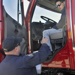 Parker Gardner, 17, of Lincoln and state Trooper Chris Foxworthy inspect a truck during a student driving competition Wednesday at the Augusta Civic Center.