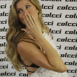 Model Gisele Bundchen poses for photos during Sao Paulo Fashion Week in Brazil on Wednesday.