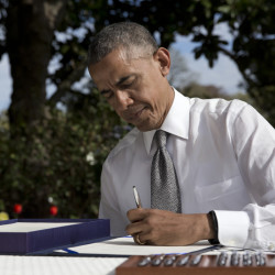President Obama signs a new Medicare reimbursement bill in the Rose Garden of the White House on Thursday.