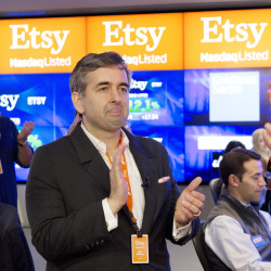 Etsy CEO Chad Dickerson applauds as his company's shares open for trading Thursday. The IPO raised about $300 million.