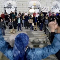 "About 100 demonstrators representing the ""black lives matter"" movement rally outside Portland City Hall on Thursday night before entering City Council Chambers, where a panel was meeting on a proposed minimum wage hike. Protesters said raising the minimum wage would directly affect blacks in the city."