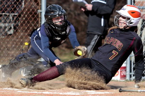 Yarmouth catcher Kallie Hutchinson applies a late tag Thursday as Tess Haller of Cape Elizabeth crosses the plate in the fourth inning of their softball opener Thursday. Yarmouth scored seven runs in the seventh inning for an 11-4 victory.