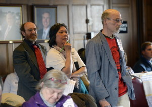 Seth Berner of Portland, Ina Demers, a teacher in Portland who lives in Wiscassett, and Bill Lee of Portland line up at Thursday's Portland City Council meeting to speak in favor of a minimum wage proposal. A City Council committee endorsed the measure, which would raise the city's minimum wage to $8.75 on July 1. The measure now goes to the full City Council. Portland's initiative is one of many competing proposals to raise Maine's minimum wage of $7.50. Shawn Patrick Ouellette/Staff Photographer