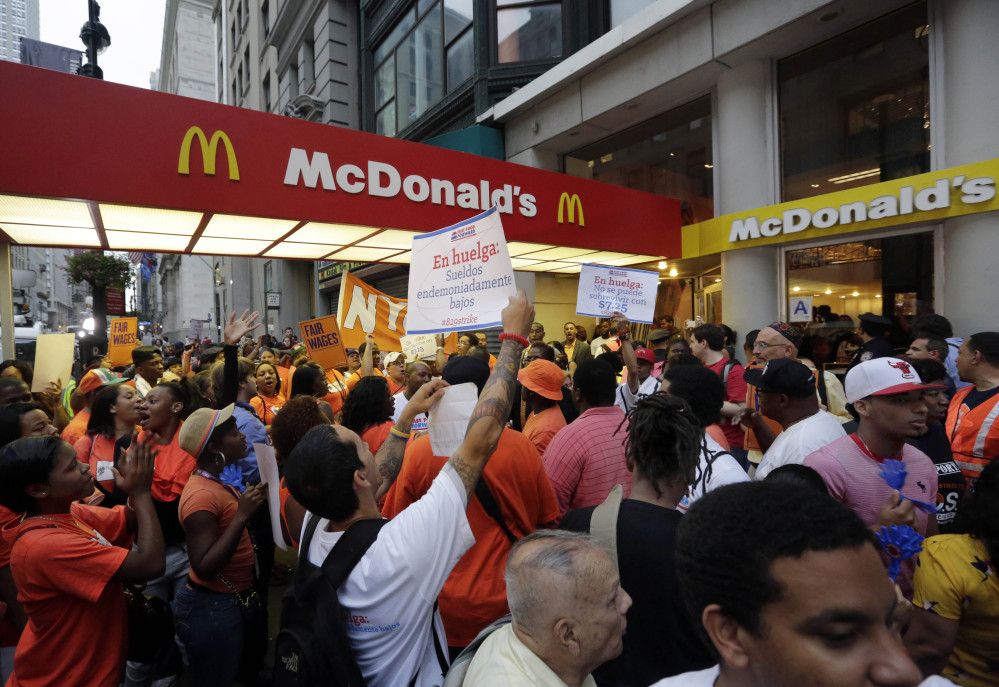 Fast-food workers protest outside a McDonald's restaurant on Fifth Avenue in New York last summer. The Associated Press