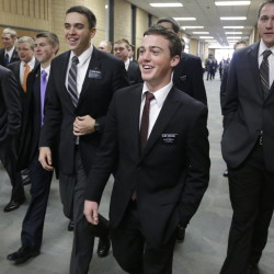 Mormon missionaries walk through the halls at the Missionary Training Center in Provo, Utah, in 2013. A record number of young Mormons signed up for missions after 2012.