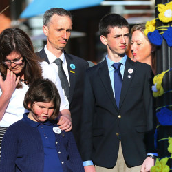 Boston Marathon bombing survivor Jane Richard, 9. left, and her brother Henry stand in front of their parents, Bill and Denise Richards, at a memorial honoring victims and survivors of the Boston Marathon bombing in Boston on Wednesday. The family lost one 8-year-old Martin in the attack on April 15, 2013.