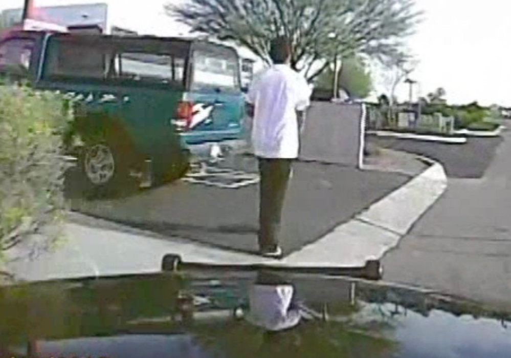 A dash-cam video shows the suspect about to get hit by the police cruiser.