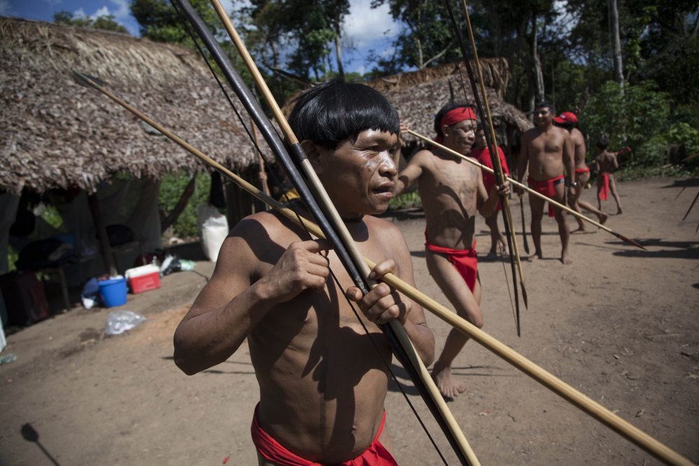 Yanomami Indians dance in Venezuela's Amazon region. Scientists have discovered that members of an isolated village have the most diverse bacteria ever reported.