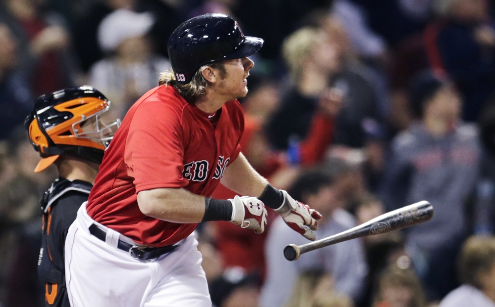 Red Sox catcher Ryan Hanigan tosses his bat as he watches the flight of his two-run home run off Baltimore Orioles pitcher Kevin Gausman in the fifth inning.