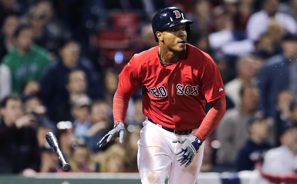 Red Sox shortstop Xander Bogaerts watches his game-winning single, which drove in teammate Mike Napoli to break a 2-2 tie with the Orioles, in the ninth inning at Fenway Park on Friday.