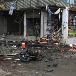 An Afghan security forces inspect at the site of suicide attack near to new Kabul Bank in Jalalabad east of Kabul, Afghanistan, Saturday, April, 18, 2015. A suicide bomb attack on a bank branch in the eastern Afghan city of Jalalabad has killed at least 30 people, officials said. Ahmad Zia Abdulzai, spokesman for the provincial governor in Nangarhar province, said on Saturday that more than 100 people were also wounded in the attack in Jalalabad, the provincial capital. (AP Photo)